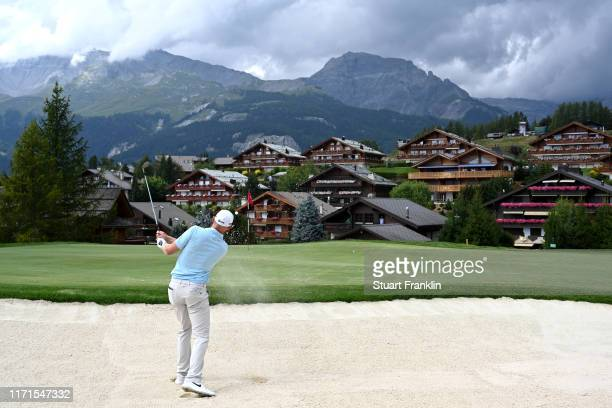 Sebastian Soderberg of Sweden plays a bunker shot on the fourteenth during Day Four of the Omega European Masters at Crans Montana Golf Club on...