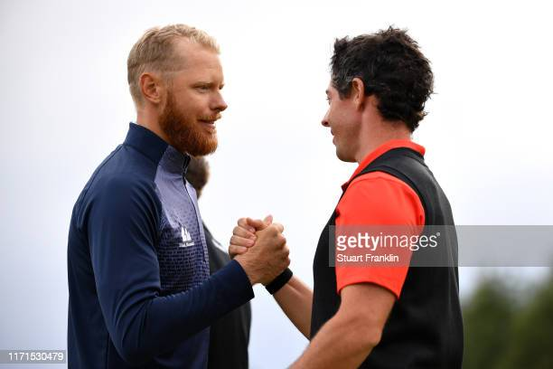 Sebastian Soderberg of Sweden shakes hands with Rory McIlroy of Northern Ireland after their playoff on the eighteenth during Day Four of the Omega...