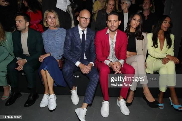Sebastian Stan Andrea Langer Mark Langer Bruna Marquezine GEazy Yasmin Wijnaldum and Laura Harrier attend the Boss fashion show during the Milan...