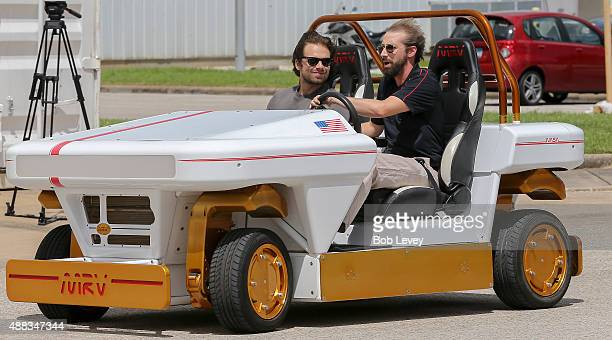 Sebastian Stan left goes for a ride with a NASA engineer in the modular robotic vehicle during his trip to NASA at Lyndon B Johnson Space Center on...
