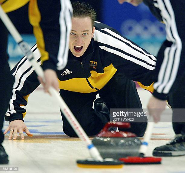 Sebastian Stock the skip for the German curling team yells after releasing the stone 15 February 2002 during his team's match against Canada in the...