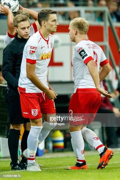 Sebastian Stolze of Jahn Regensburg comes on as a substitute for Alexander Nandzik of Jahn Regensburg during the Second Bundesliga match between SSV...