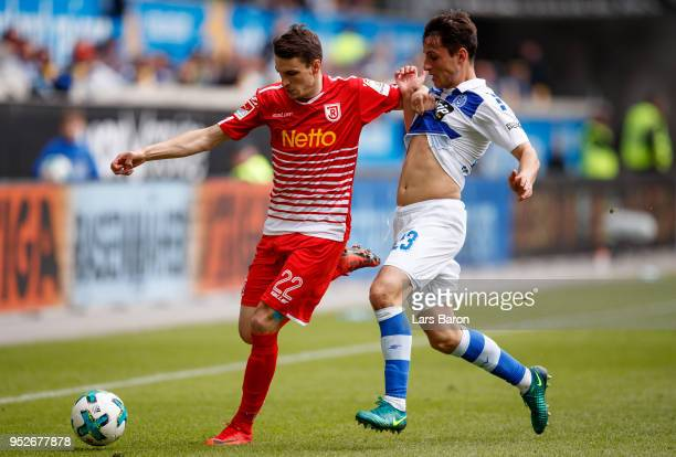 Sebastian Stolze of Regensburg is challenged by Fabian Schnellhardt of Duisburg during the Second Bundesliga match between MSV Duisburg and SSV Jahn...
