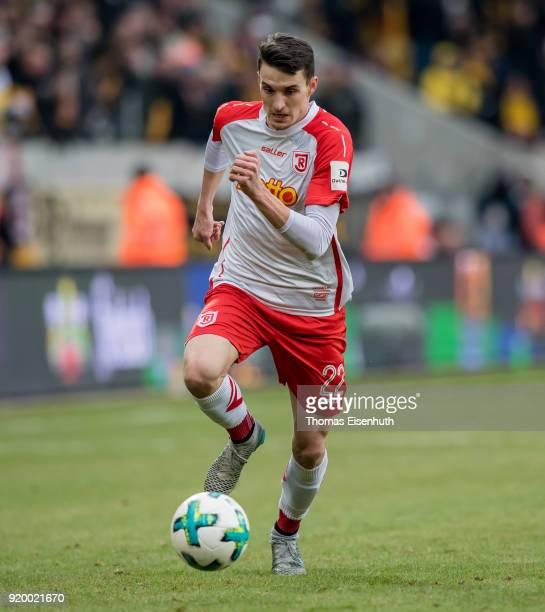 Sebastian Stolze of Regensburg plays the ball during the Second Bundesliga match between SG Dynamo Dresden and SSV Jahn Regensburg at DDVStadion on...