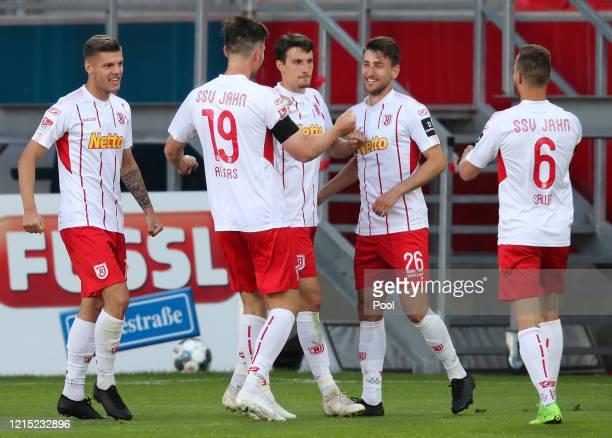 Sebastian Stolze of SSV Jahn Regensburg celebrates with teammates after scoring his team's second goal during the Second Bundesliga match between SSV...