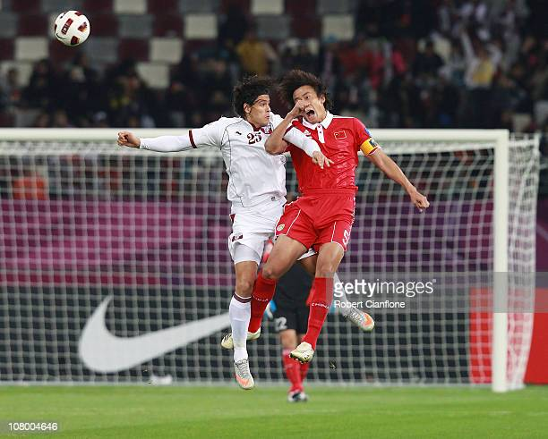 Sebastian Suria of Qatar challenges Du Wei of China PR during the AFC Asian Cup Group A match between China PR and Qatar at Khalifa Stadium on...