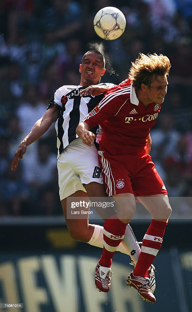 Sebastian Svaerd of Monchengladbach goes up for a header with Andreas Ottl of Munich during the Bundesliga match between Borussia Monchengladbach and Bayern Munich at the Borussia Park on May 5, 2007 in Monchengladbach, Germany.