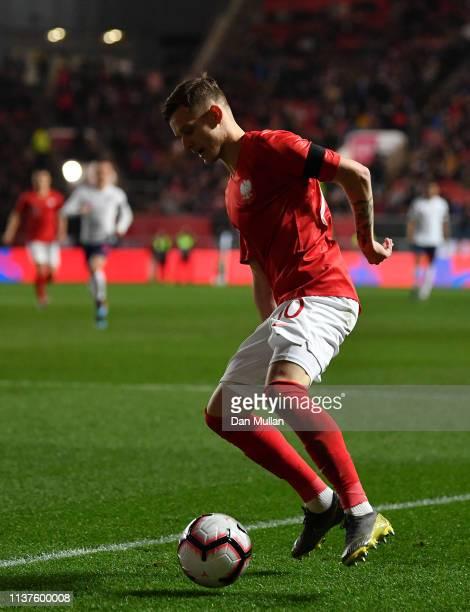 Sebastian Szymanski of Poland controls the ball during the International Friendly match between England U21 and Poland U21 at Ashton Gate on March 21...