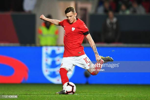 Sebastian Szymanski of Poland shoots and scores his teams first goal of the game during the U21 International Friendly match between England and...