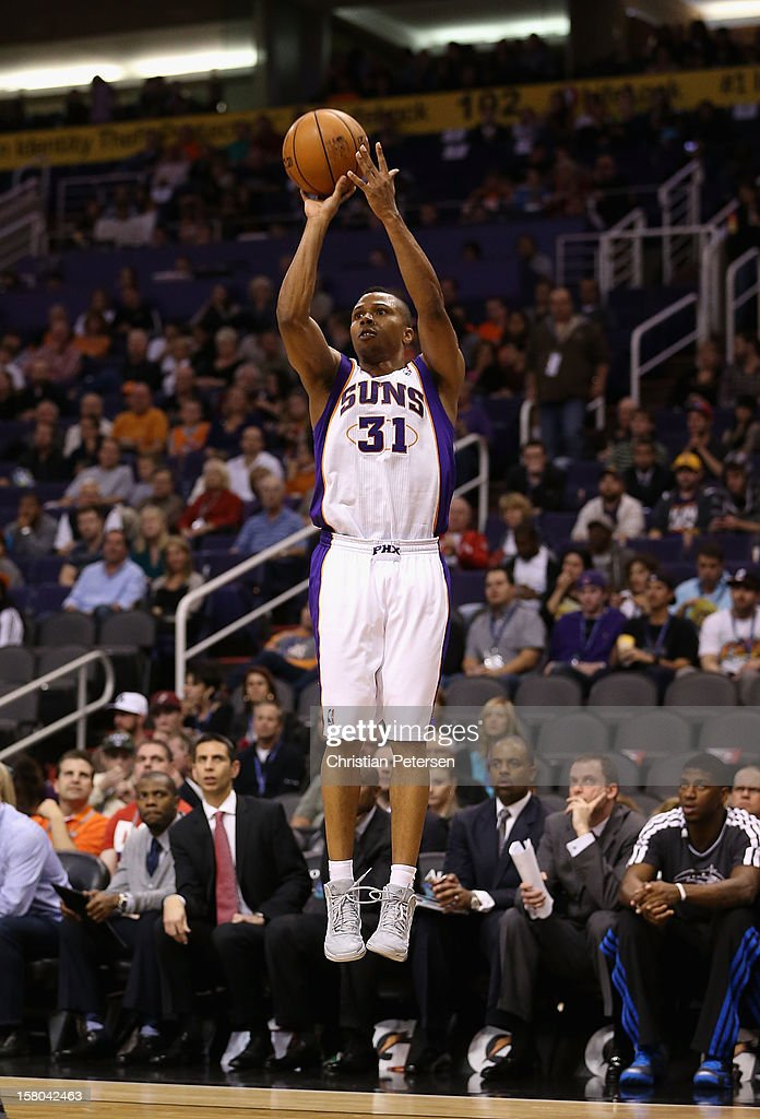 Sebastian Telfair #31 of the Phoenix Suns attempts a three point shot against the Orlando Magic during the NBA game at US Airways Center on December 9, 2012 in Phoenix, Arizona. The Magic defeated the Suns 98-90.