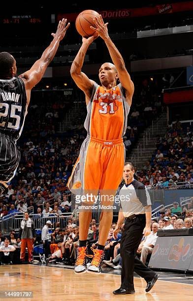 Sebastian Telfair of the Phoenix Suns takes a jump shot over Chris Duhon of the Orlando Magic during the game on March 21 2012 at Amway Center in...