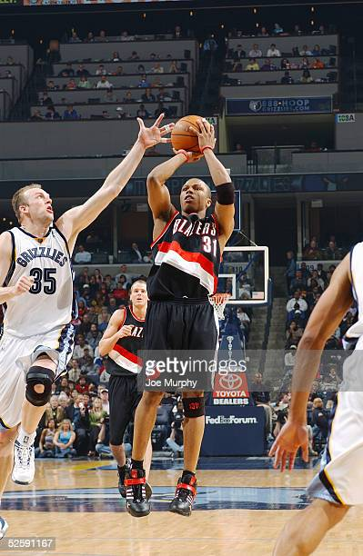 Sebastian Telfair of the Portland Trail Blazers shoots during the game with the Memphis Grizzlies at FedexForum on March 14 2005 in Memphis Tennessee...
