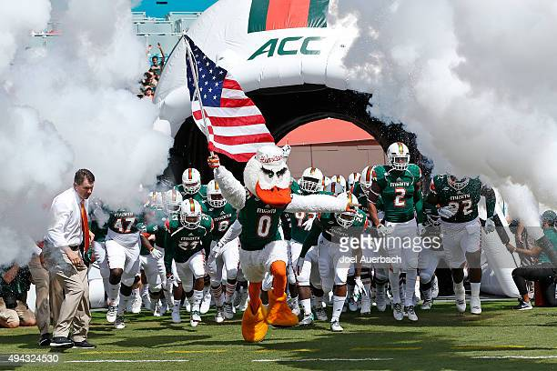 Sebastian the Ibis the Miami Hurricanes mascot leads the team only the field for their game against the Clemson Tigers on October 24 2015 at Sun Life...