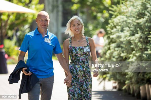 Sebastian Thrun cofounder and president of Udacity and chief executive officer of the Kitty Hawk Corporation walks with Doreen Xia as they attend the...