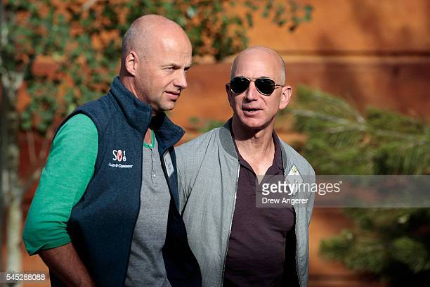 Sebastian Thrun founder of Udacity and GoogleX walks with Jeff Bezos chief executive officer of Amazoncom Inc and founder of Blue Origin as they...