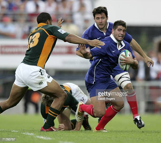 Sebastian Tillous-Borde, the France scrumhalf races away from Waylon Murray during the IRB under 21's Rugby World Cup between France and South Africa...