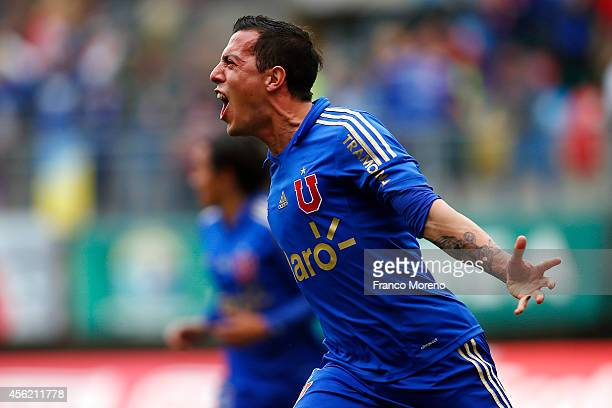 Sebastian Ubilla of U de Chile celebrates his team's second goal during a match between Audax Italiano and U de Chile as part of ninth round of...