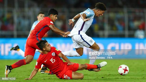 Sebastian Valencia and Antonio Diaz of Chile battles for the ball with Jadon Sancho of England during the FIFA U17 World Cup India 2017 group F match...