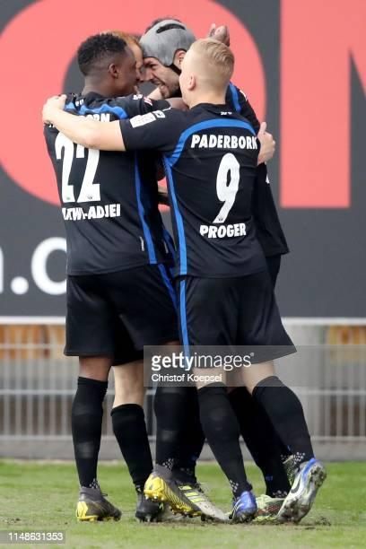 Sebastian Vasiliadis of Paderborn celebrates the second goal with Christopher AbntwiAdjei L Klaus Gjasula a nd Kai Proeger of Paderborn during the...