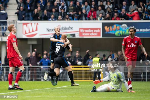 Sebastian Vasiliadis of SC Paderborn celebrates with Sven Michel of SC Paderborn after scoring his team's first goal during the Second Bundesliga...