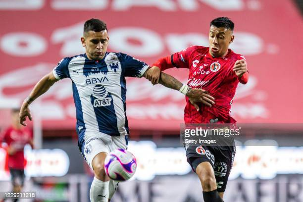 Sebastian Vegas of Monterrey fights for the ball with Edgar Lopez of Tijuana during the Final first leg match between Tijuana and Monterrey as part...