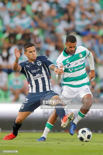 Sebastian Vegas of Monterrey struggles for the ball with Alessio da Cruz of Santos during the 10th round match between Santos Laguna and Monterey as...