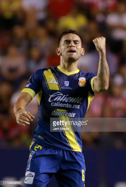 Sebastian Vegas of Morelia celebrates after scoring the first goal of his team during the 7th round match between Atletico San Luis and Morelia as...