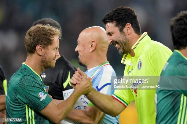 Sebastian Vettel and Gianluigi Buffon during the 'Partita Del Cuore' Charity Match at Allianz Stadium on May 27, 2019 in Turin, Italy.