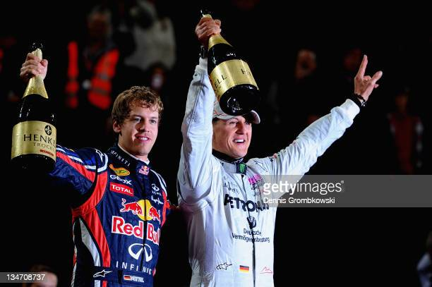 Sebastian Vettel and Michael Schumacher celebrate after winning the Nations Cup at day one of the race of champions event at the Esprit Arena on...