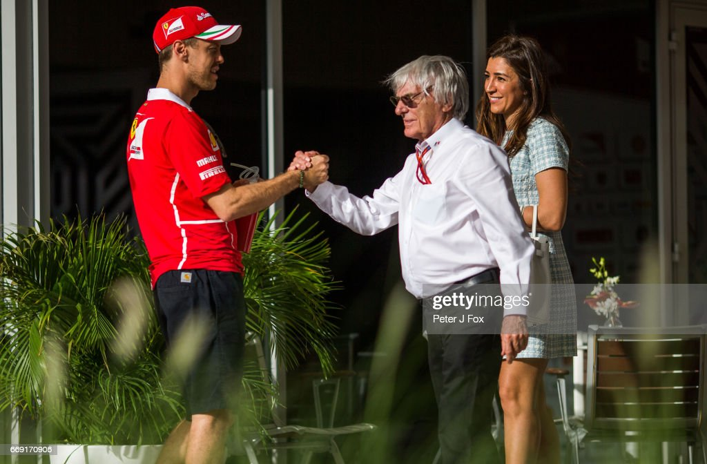 Sebastian Vettel of Ferrari and Germany Bernie Ecclestone (GBR) during the Bahrain Formula One Grand Prix at Bahrain International Circuit on April 16, 2017 in Bahrain, Bahrain.