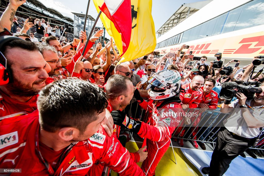 Sebastian Vettel of Ferrari and Germany celebrates winning with his team during the Formula One Grand Prix of Hungary at Hungaroring on July 30, 2017 in Budapest, Hungary.