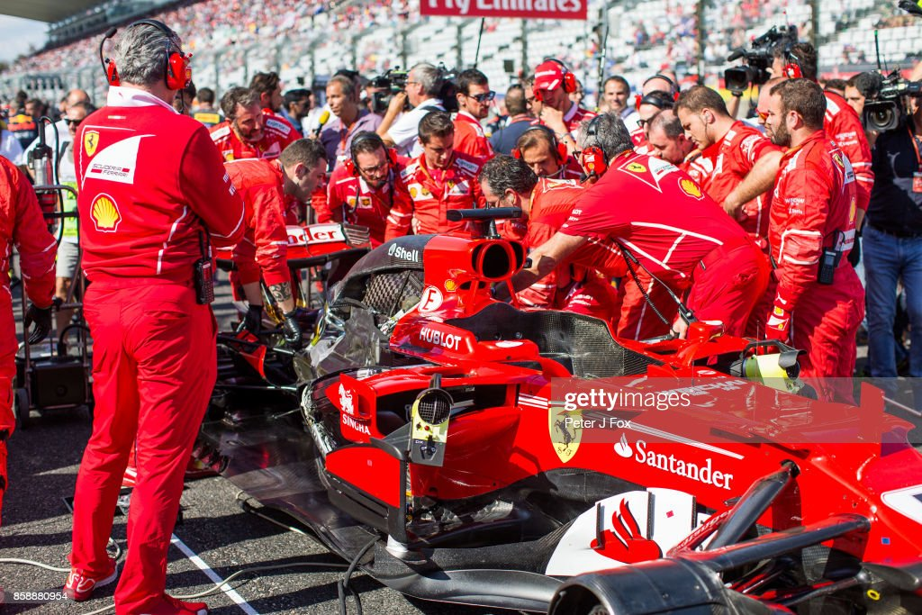 Sebastian Vettel of Ferrari and Germany has his car worked on prior to the race during the Formula One Grand Prix of Japan at Suzuka Circuit on October 8, 2017 in Suzuka.