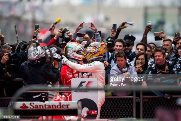 Sebastian Vettel of Ferrari and Germany with Lewis Hamilton of Mercedes and Great Britain during the Formula One Grand Prix of China at Shanghai...