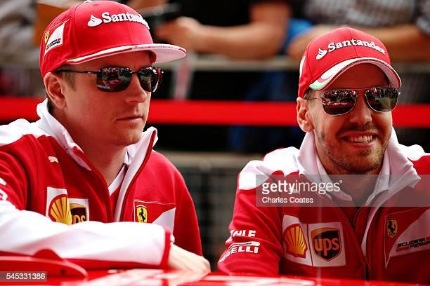 Sebastian Vettel of Germaany and Ferrari nd Kimi Raikkonen of Finland and Ferrari in the Pitlane during previews ahead of the Formula One Grand Prix...