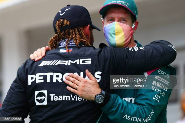 Sebastian Vettel of Germany and Aston Martin embraces Lewis Hamilton of Great Britain and Mercedes AMG Petronas in parc ferme after the F1 Grand Prix...