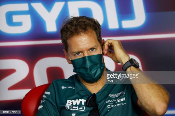 Sebastian Vettel of Germany and Aston Martin F1 Team talks in the Drivers Press Conference during previews ahead of the F1 Grand Prix of Hungary at...