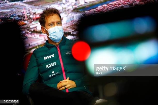 Sebastian Vettel of Germany and Aston Martin F1 Team talks in the Drivers Press Conference during previews ahead of the F1 Grand Prix of Russia at...