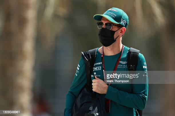 Sebastian Vettel of Germany and Aston Martin F1 Team walks in the Paddock during previews ahead of the F1 Grand Prix of Bahrain at Bahrain...