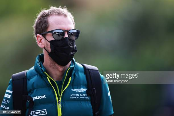 Sebastian Vettel of Germany and Aston Martin F1 Team walks in the Paddock before final practice ahead of the F1 Grand Prix of Emilia Romagna at...