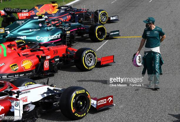 Sebastian Vettel of Germany and Aston Martin walks amongst the cars on the grid during a photoshoot on Day One of F1 Testing at Bahrain International...