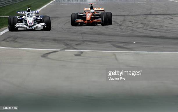 Sebastian Vettel of Germany and BMW Sauber leads Adrian Sutil of Germany and Spyker F1 during the F1 Grand Prix of USA at the Indianapolis Motor...