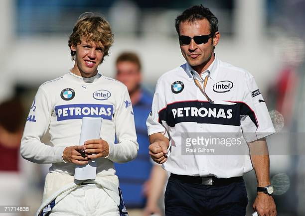 Sebastian Vettel of Germany and BMW Sauber walks down the paddock with his team manager following second practice for the Turkish Formula One Grand...