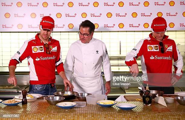 Sebastian Vettel of Germany and Ferrari and Kimi Raikkonen of Finland and Ferrari speak with chef Guy Grossi in the kitchen of the Merchant...