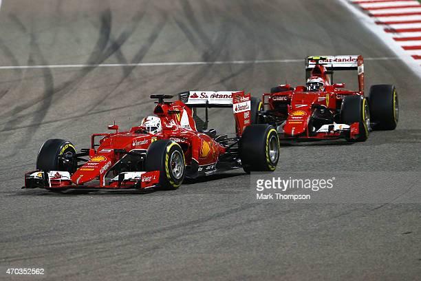 Sebastian Vettel of Germany and Ferrari and Kimi Raikkonen of Finland and Ferrari drive during the Bahrain Formula One Grand Prix at Bahrain...