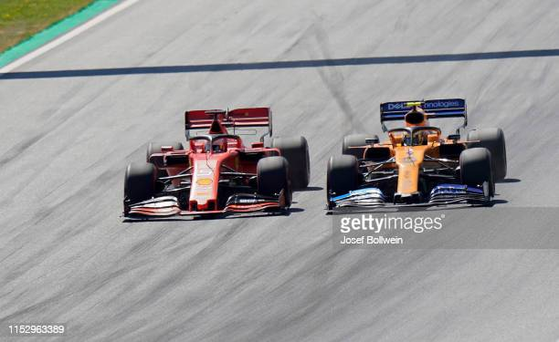Sebastian Vettel of Germany and Ferrari and Lando Norris of Great Britain and McLaren during the F1 Grand Prix of Austria at Red Bull Ring on June...