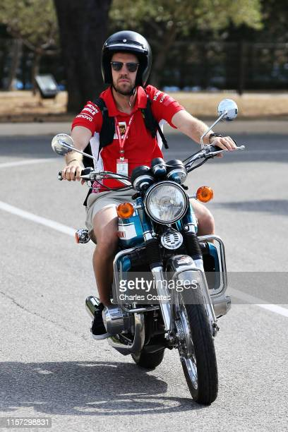 Sebastian Vettel of Germany and Ferrari arrives at the circuit before practice for the F1 Grand Prix of France at Circuit Paul Ricard on June 21,...