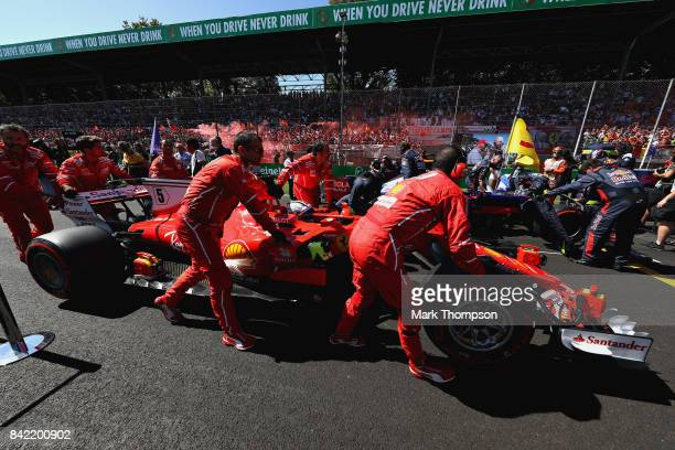 Sebastian Vettel of Germany and Ferrari arrives on the grid before the Formula One Grand Prix of Italy at Autodromo di Monza on September 3 2017 in...