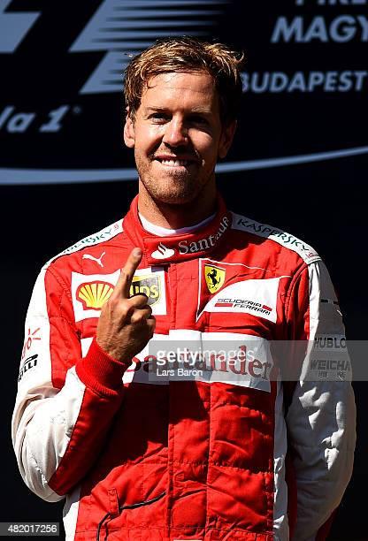 Sebastian Vettel of Germany and Ferrari celebrates after winning the Formula One Grand Prix of Hungary at Hungaroring on July 26 2015 in Budapest...