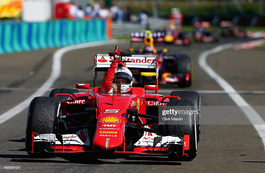 Sebastian Vettel of Germany and Ferrari celebrates as he approaches Parc Ferme after winning the Formula One Grand Prix of Hungary at Hungaroring on July 26, 2015 in Budapest, Hungary.