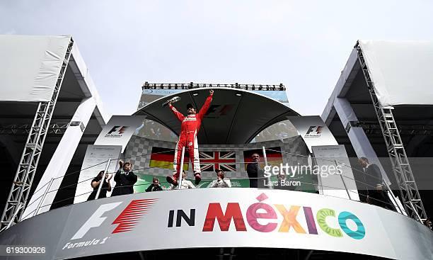 Sebastian Vettel of Germany and Ferrari celebrates fnishing in third on the podium during the Formula One Grand Prix of Mexico at Autodromo Hermanos...